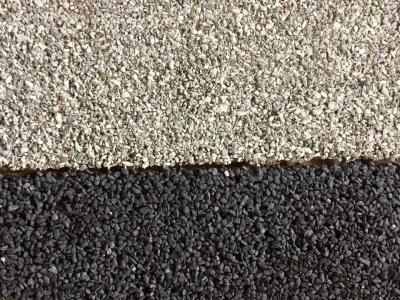 Detail of ECO PAVE SYSTEM-treated Botticino chip and Ivory Black chip