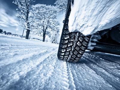 Snow-covered and frozen road: source of danger